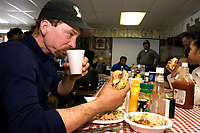 Lance Mackey chows down on complimentary meal @ Takotna Chkpt 2006 Iditarod<br /> inside Alaska Winter