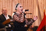 PLANTSVILLE, CT- 27 November 2015-112715EC05--   Aurela Gace sings during the celebration of Albania's Independence Day at the Aqua Turf in Plantsville. Music and dancing also highlighted the night, along with Albanian speakers. The event, known as Albanian Flag Day, sold out quickly. Erin Covey Republican-American.