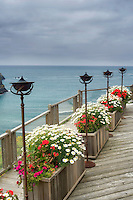View of ocean deck with flower benches and lanterns. Greenwood Pier.Elk. Californai
