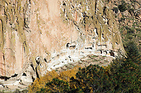 Frijoles Canyon at Bandelier National Monument, New Mexico.  Showing the archeological features, along the cliff face, left by the Ancestral Pueblo People (Anasazi).  Long House