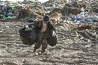Rag pickers scrape a living on a filthy landfill site north of Kabul. They were collecting plastic to sell for recycling from houshold, restaurant and hospital waste. Most were children and were earning arounf 50 afghanis (1 US dollar) a day.
