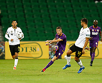 23rd May 2021; HBF Park, Perth, Western Australia, Australia; A League Football, Perth Glory versus Macarthur; Callum Timmins of Perth Glory clears the ball from defence as Loic Puyo of Macarthur FC closes in to challenge