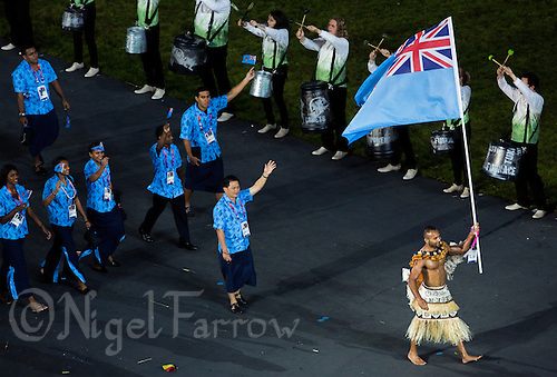27 JUL 2012 - LONDON, GBR - Judo competitor Josateki Naulu (FIJ) leads the team from Fiji into the Olympic Stadium during the Opening Ceremony of the London 2012 Olympic Games in Stratford, London, Great Britain (PHOTO (C) 2012 NIGEL FARROW)