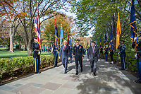 From left to right: Vice President Mike Pence; U.S. Army Maj. Gen. Omar Jones IV, commanding general, U.S. Army Military District of Washington; and Secretary of Veterans Affairs Robert Wilkie walk through the State and Territorial Flag cordon on their way to the Tomb of the Unknown Soldier at Arlington National Cemetery, Arlington, Virginia, Nov. 11, 2019. Vice President Pence laid a wreath at the Tomb of the Unknown Soldier and spoke to the crowd in the Memorial Amphitheatre as part of the National Veterans Day Observance. (U.S. Army photo by Elizabeth Fraser / Arlington National Cemetery / released)