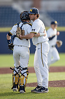 Michigan Wolverines pitcher Karl Kauffmann (37) celebrates with catcher Joe Donovan (0) after defeating the San Jose State Spartans on March 27, 2019 in Game 1 of the NCAA baseball doubleheader at Ray Fisher Stadium in Ann Arbor, Michigan. Michigan defeated San Jose State 1-0. (Andrew Woolley/Four Seam Images)