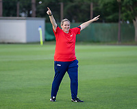 KASHIMA, JAPAN - AUGUST 1: Laura Harvey of the USWNT talks to the team during a training session at the practice field on August 1, 2021 in Kashima, Japan.