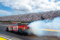 Jul 12, 2020; Clermont, Indiana, USA; NHRA funny car driver Alexis DeJoria does a burnout during the E3 Spark Plugs Nationals at Lucas Oil Raceway. This is the first race back for NHRA since the start of the COVID-19 global pandemic. Mandatory Credit: Mark J. Rebilas-USA TODAY Sports