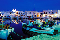 Paros, Greek Islands, Naoussa, Cyclades, Greece, Europe, Fishing boats docked in Naoussa Harbor in the evening on Paros Island on the Aegean Sea.