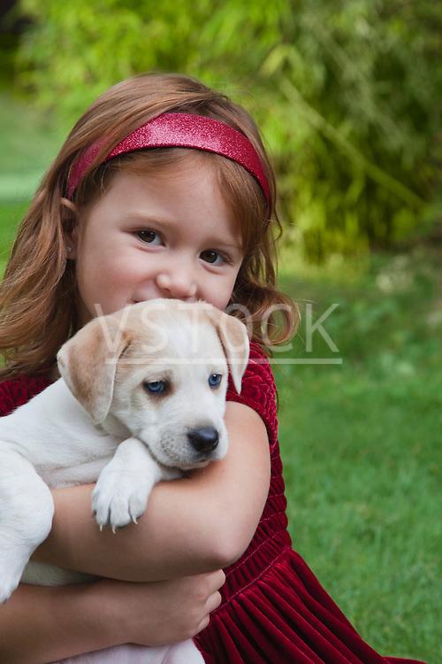 USA, California, Fairfax, portrait of girl (4-5) holding Beagle puppy, outdoors