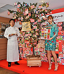 """Japanese model Nicole Fujita and Owner chef, Le Patissier Takagi, Yasumasa Takagi pose for camera during an event for the 45th anniversary of Chocolate snack """"Kit Kat"""" at the Kit Kat Chocolatory Ginza in Tokyo, Japan on November 14, 2018. (Photo by AFLO)"""