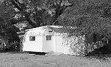 """American Ingenuity at its finest.  A three-bedroom house built around a mobile home trailer.  Image captured in Oracle, Arizona.  20"""" x 12"""".  Printed on Parrot Digigraphic Ultra Lustre Photopaper.  Limited Edition of 25."""