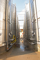 Mas La Chevaliere. near Beziers. Languedoc. Outside tanks. Stainless steel fermentation and storage tanks. Cooling coils for temperature control. France. Europe.