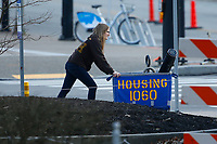A girl pushes a housing cart with her belongings on the University of Pittsburgh campus in the Oakland neighborhood on Sunday March 15, 2020 in Pittsburgh, Pennsylvania. (Photo by Jared Wickerham/Pittsburgh City Paper)