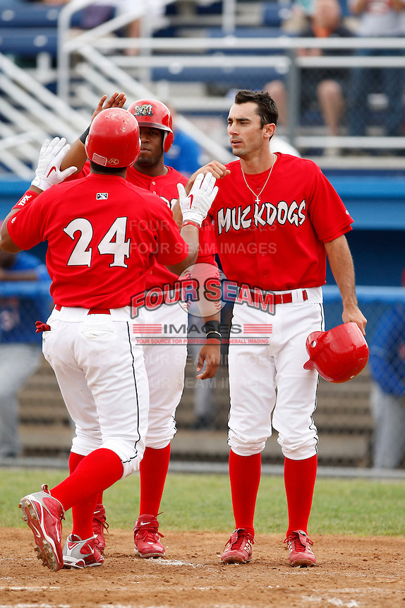 June 21, 2009:  Matt Carpenter of the Batavia Muckdogs greets Ryde Rodriguez with Xavier Scruggs after Rodriguez three run home run during a game at Dwyer Stadium in Batavia, NY.  The Muckdogs are the NY-Penn League Short-Season Class-A affiliate of the St. Louis Cardinals.  Photo by:  Mike Janes/Four Seam Images