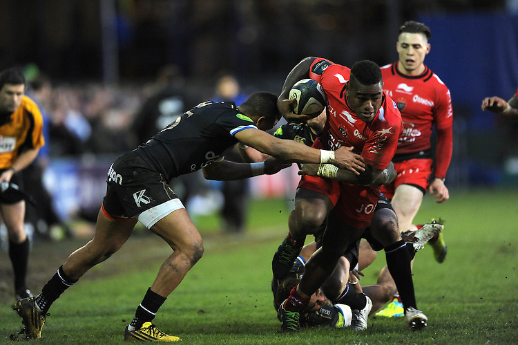 Josua Tuisova of RC Toulon forces his way through the tackle of Chris Cook and Anthony Watson of Bath Rugby during the European Rugby Champions Cup match between Bath Rugby and RC Toulon - 23/01/2016 - The Recreation Ground, Bath Mandatory Credit: Rob Munro/Stewart Communications