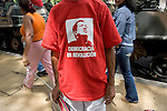 A supporter of  Venezuelan president Hugo Chavez displays a t-shirt with his face after a military parade in Caracas, Venezuela, on Wednesday, Jul. 05, 2006. The military parade was to celebrate the 195th anniversary of the Venezuelan Independence from Spain. (ALTERPHOTOS/Alvaro Hernandez)