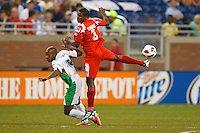 Guadeloupe midfielder Thery Racon (10) and Panama defender Harold Cummings (3) during the CONCACAF soccer match between Panama and Guadeloupe at Ford Field Detroit, Michigan.