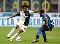 Calcio, Serie A: Inter Milano - Juventus, Giuseppe Meazza stadium, October 6 2019.<br /> Juventus' Juan Cuadrado (l) in action with Inter's Kwadwo Asamoah  (r) during the Italian Serie A football match between Inter and Juventus at Giuseppe Meazza (San Siro) stadium, October 6, 2019.<br /> UPDATE IMAGES PRESS/Isabella Bonotto