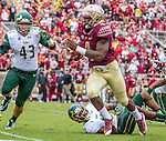 Florida State's  Terrance Smith dives for South Florida's Darius Tice in an NCAA college football game in Tallahassee, Fla., Saturday, Sept. 12, 2015. The FSU Seminoles defeated the South Florida Bulls 34-14.