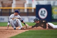 Burlington Bees second baseman Brendon Sanger (23) reaches back attempting to tag Aaron Mizell stealing second during a game against the Quad Cities River Bandits on May 9, 2016 at Modern Woodmen Park in Davenport, Iowa.  Quad Cities defeated Burlington 12-4.  (Mike Janes/Four Seam Images)