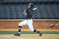 Michael Ludowig (22) of the Wake Forest Demon Deacons follows through on his swing against the Virginia Cavaliers at David F. Couch Ballpark on May 18, 2018 in  Winston-Salem, North Carolina.  The Cavaliers defeated the Demon Deacons 15-3.  (Brian Westerholt/Four Seam Images)