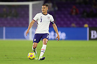 ORLANDO CITY, FL - JANUARY 31: Aaron Long #3 of the United States looks for an open man during a game between Trinidad and Tobago and USMNT at Exploria stadium on January 31, 2021 in Orlando City, Florida.