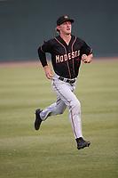 Connor Kopach (7) of the Modesto Nuts runs before a game against the Visalia Rawhide at Recreation Ballpark on June 10, 2019 in Visalia, California. (Larry Goren/Four Seam Images)