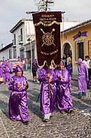 Antigua, Guatemala.  Members Carrying the Banner of the Brotherhood (Hermandad), the Lay Organization Responsible for Organizing a Religious Procession during Holy Week, La Semana Santa.