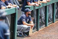 Liberty Flames assistant coach Tyler Cannon looks on from the dugout during the game against the Duke Blue Devils in NCAA Regional play on Robert M. Lindsay Field at Lindsey Nelson Stadium on June 4, 2021, in Knoxville, Tennessee. (Danny Parker/Four Seam Images)