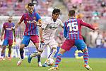FC Barcelona's Sergio Busquets (l) and Clement Lenglet (r) and Getafe CF's Jose Juan Macias during La Liga match. August 29, 2021. (ALTERPHOTOS/Acero)