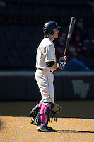 Ben Breazeale (9) of the Wake Forest Demon Deacons waits for his turn to hit against the Virginia Tech Hokies at Wake Forest Baseball Park on March 7, 2015 in Winston-Salem, North Carolina.  The Hokies defeated the Demon Deacons 12-7 in game one of a double-header.   (Brian Westerholt/Four Seam Images)