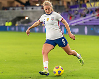 ORLANDO, FL - JANUARY 18: Lindsey Horan #9 of the USWNT crosses the ball during a game between Colombia and USWNT at Exploria Stadium on January 18, 2021 in Orlando, Florida.