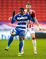 6th February 2021; Bet365 Stadium, Stoke, Staffordshire, England; English Football League Championship Football, Stoke City versus Reading; Lucas Joao of Reading under pressure from Nathan Collins of Stoke City