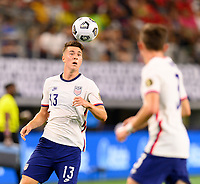 DALLAS, TX - JULY 25: Matthew Hoppe #13 of the United States gains control of a loose ball during a game between Jamaica and USMNT at AT&T Stadium on July 25, 2021 in Dallas, Texas.
