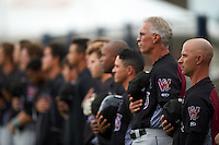 Wisconsin Timber Rattlers manager Matt Erickson (8) and pitching coach Gary Lucas (25) lead the lineup for the national anthem before the first game of a doubleheader against the Quad Cities River Bandits on August 19, 2015 at Modern Woodmen Park in Davenport, Iowa.  Quad Cities defeated Wisconsin 3-2.  (Mike Janes/Four Seam Images)