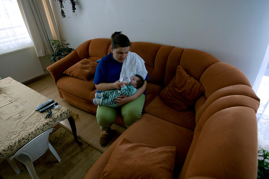 While her husband and elder son are out working and playing, Anna stays home and takes care of the latest addition to the little family. His name is Piotr (Peter) and he is only three weeks old. Jareks flexible hours come in quite handy as he can come home and watch over Piotr awhile Anna shops for groceries and runs errands.