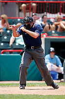June 25, 2009:  Home plate umpire Johnny Conrad makes a call during a game at Jerry Uht Park in Erie, PA.  Photo by:  Mike Janes/Four Seam Images