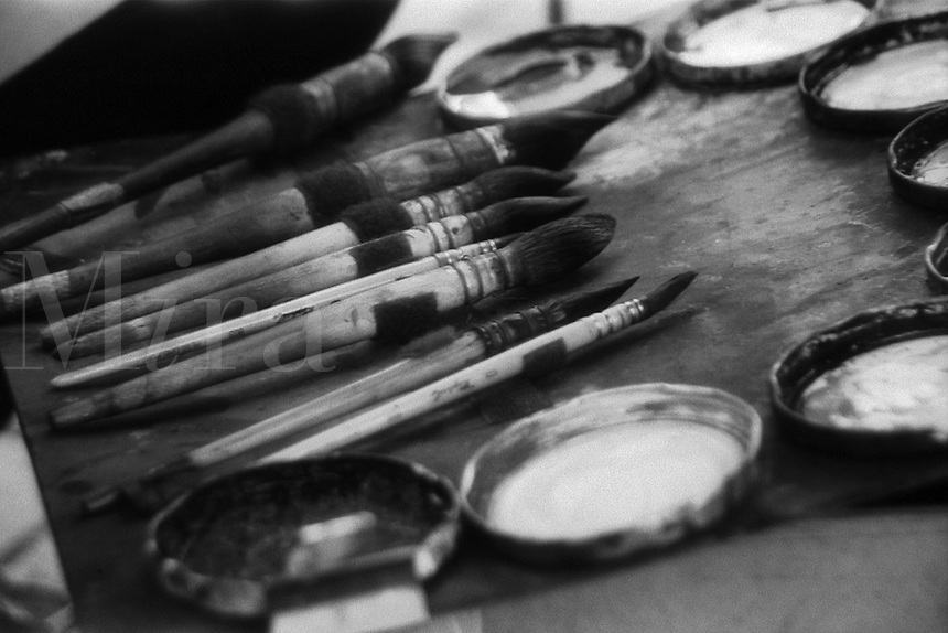 Artists' brushes and paints at Montmartre, Paris, France