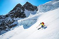 Skiing amongst seracs the Rosenlaui Glacier on the last day of the Berner Haute Route, Switzerland