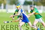 Tralee Parnells Graham Sheehy about to be tackled by Evan Kelliher of Lixnaw in the U16 Hurling plate final.