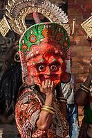 Bhaktapur, Nepal.  Masked Figure in Durbar Square.