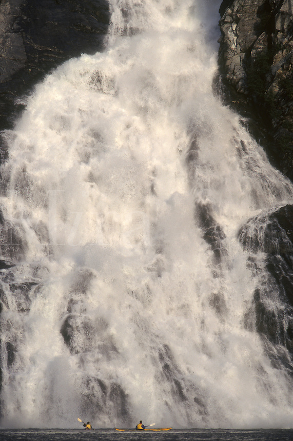 Kayakers experience the thunder of Nugget Falls from Mendenhall Lake in Juneau, Alaska.