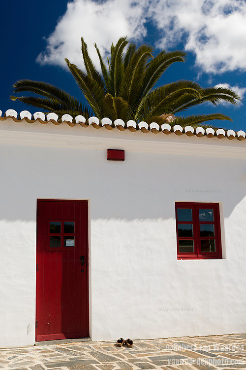 Sandals outside the white and red yoga studio at Pedralva in South West Portugal.