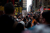 """New York, New York<br /> November 15, 2011<br /> <br /> After the police clear Zuccotti Park many of the evicted """"Occupy Wall Street"""" protesters, reconvened in Foley Square and march to  Juan Pablo Duarte Square at Canal and 6th Ave.<br /> <br /> They return before noon to Zuccotti Park to wait a court order to reenter the park. Small scuffles break out between the police and the protesters resulting in a few arrests."""