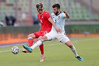 6th June 2021, Stade Josy Barthel, Luxemburg; International football friendly Luxemburg versus Scotland;  Maurice Deville Luxembourg chalenged by Grant Hanley Scotland
