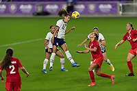 ORLANDO CITY, FL - FEBRUARY 18: Alex Morgan #13 heads the ball during a game between Canada and USWNT at Exploria stadium on February 18, 2021 in Orlando City, Florida.