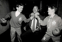 1989 FILE PHOTO - ARCHIVES -<br /> <br /> This guy don't look so tough to me': Matt Sheedy and Scott Manson: both 9 years old: give former world heavyweight champion Larry Holmes the old 1-2 yesterday at the Ontario Science Centre.