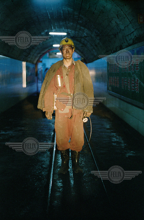 Miner at the state owned coal mine.  Shanxi is the largest producer of coal in China.  The rate of coal mining in the country is increasing from an annual production of over 2 billion tons in order to cater for China's rapid economic growth.