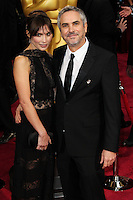 HOLLYWOOD, LOS ANGELES, CA, USA - MARCH 02: Sheherazade Goldsmith, Alfonso Cuaron at the 86th Annual Academy Awards held at Dolby Theatre on March 2, 2014 in Hollywood, Los Angeles, California, United States. (Photo by Xavier Collin/Celebrity Monitor)