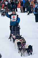 Sven Haltman team leaves the start line during the restart day of Iditarod 2009 in Willow, Alaska